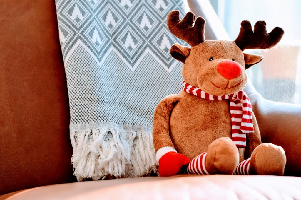 A stuffed reindeer doll, smiling